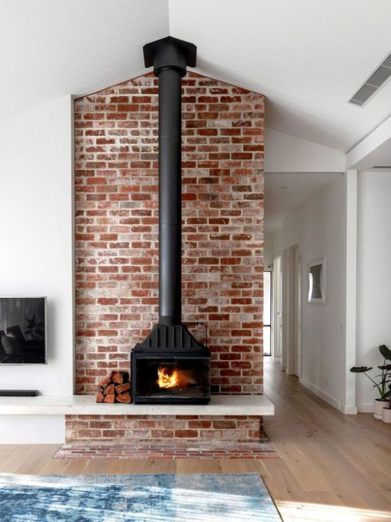 Home Wood Burning Stove In Red Brick Wall