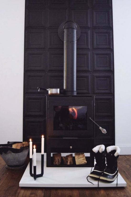 Home Wood Burning Stove With A Black Panel Wall