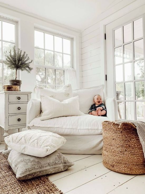 Living Room Decor With Knits A Jute Rug And A Basket