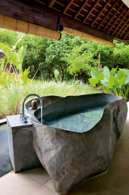 Outdoor Bathroom With Stone Bathtub With Uneven Edges