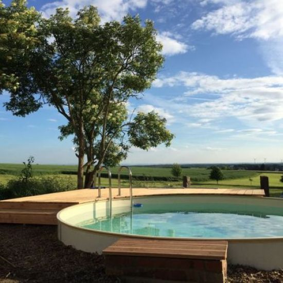 Raised Round Pool With A Minimal Wooden Deck
