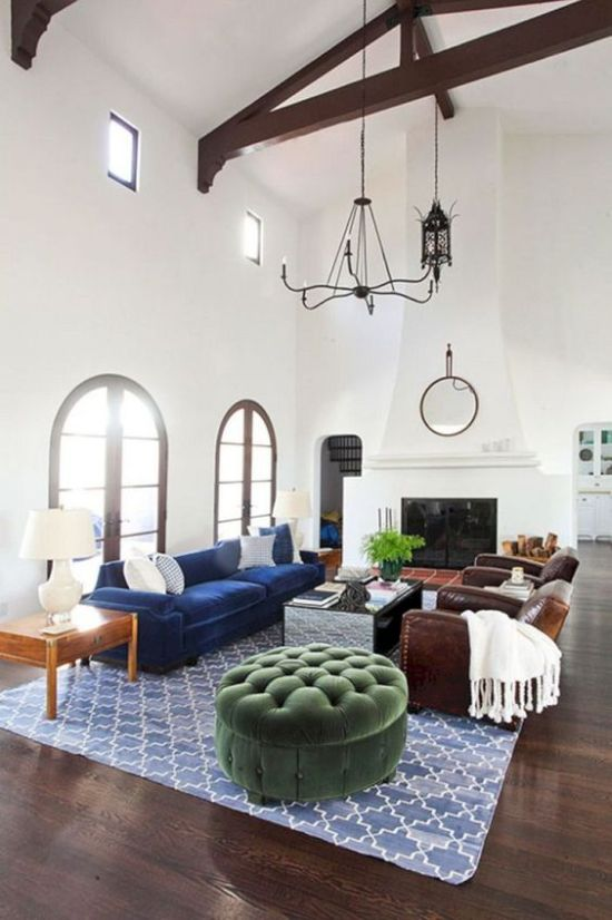 Spanish Living Room Decor With White Walls And A Double-Height Ceiling