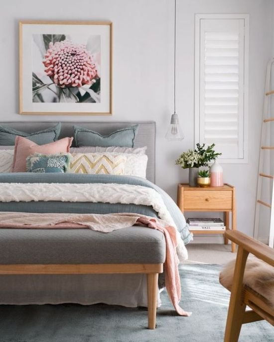 Spring Bedroom Decor With Fresh Blooms In A Vase And Pink Floral Artwork