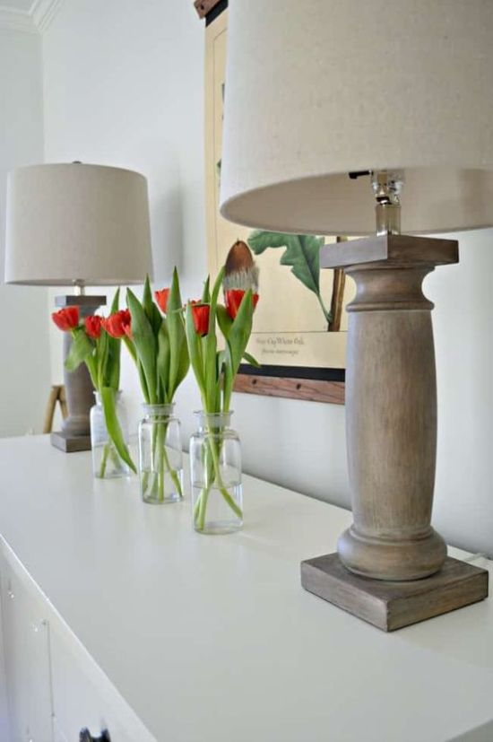 Spring Home Decor With Clear Bottles With Red Tulips