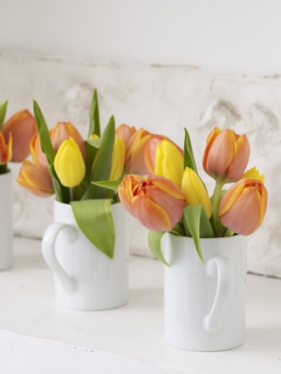 Spring Home Decor With White Teacups With Colorful Tulips