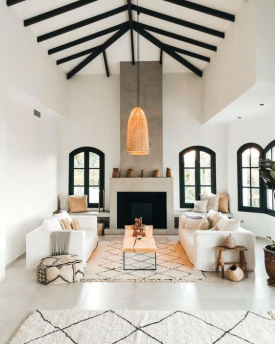 Traditional Spanish Living Room With A Concrete Fireplace