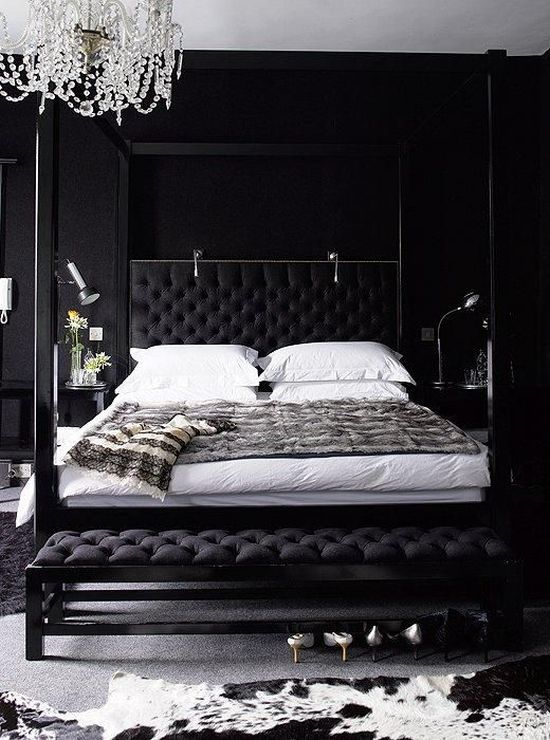 Black Bedroom With A Refined Crystal Chandelier