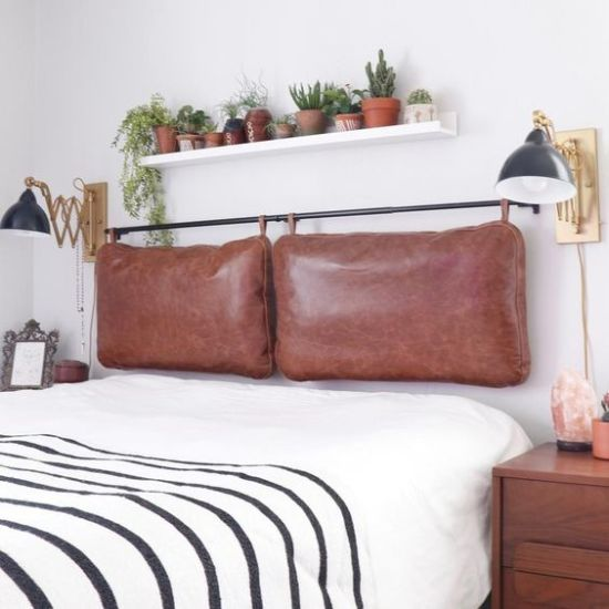 Boho Bedroom With A Brown Leather Pillow Hanging Headboard