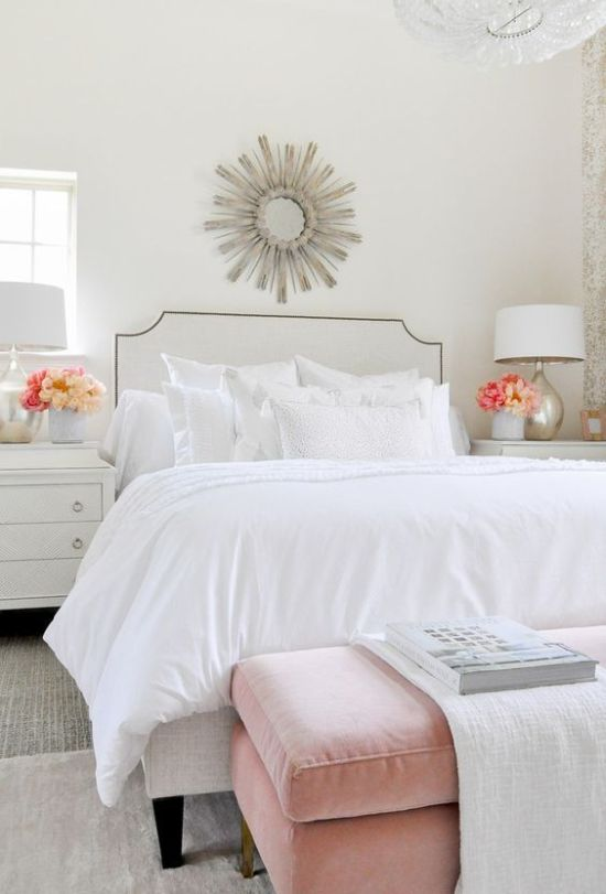 Chic Bedroom With A White Bed And White Pillows