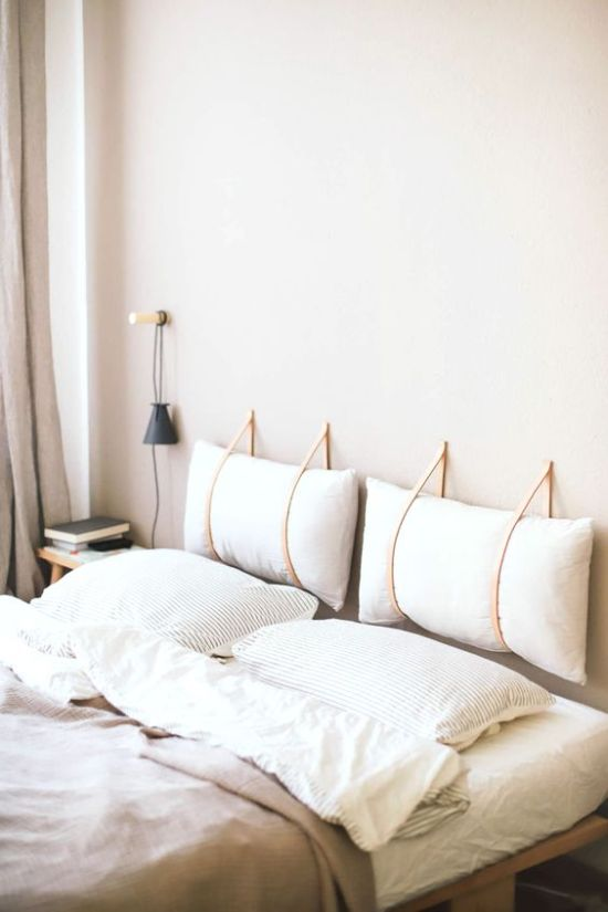 Headboard Idea With Two Pillows Hanging On Leather
