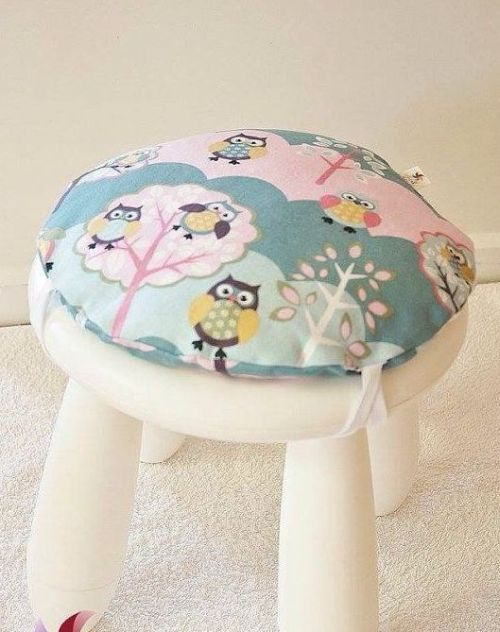 White IKEA Mammut Stool With A Colorful Pillow