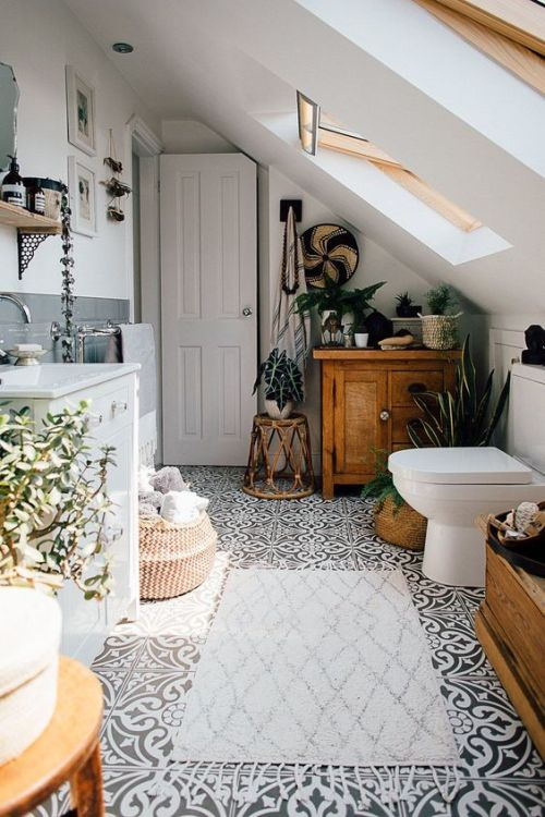 Attic Bathroom With Potted Greenery And Succulents