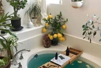 Bathtub Surrounded By Greenery And Succulents