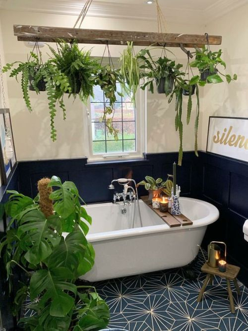 Bold Navy And Neutral Bathroom With Potted Green Plants