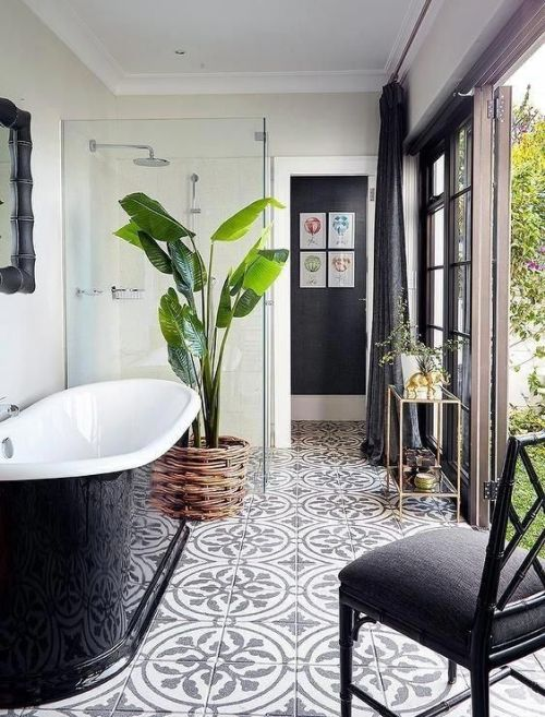 Chic Monochromatic Bathroom With A Statement Plant In A Wicker Pot