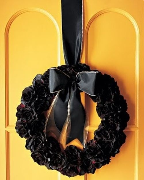 Black Fabric Flower Wreath With A Black Ribbon Bow