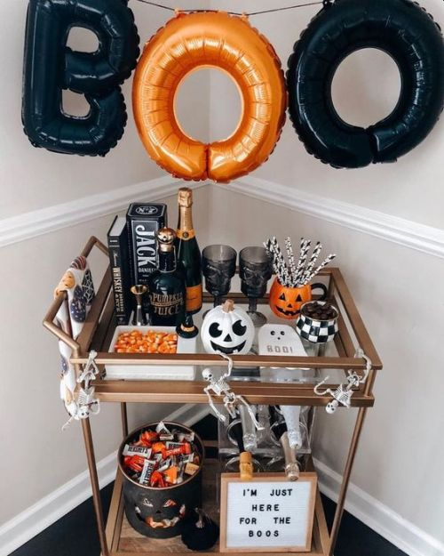 Halloween Bar Cart With An Orange And Black Letter Garland