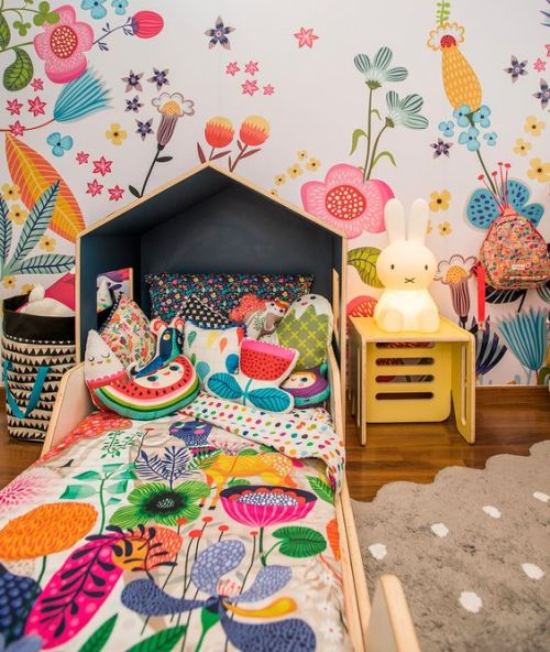 Colorful Kids Room With Floral Wall And Pillows