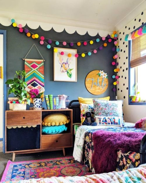 Colorful Kids Room With Pompom And Pillows