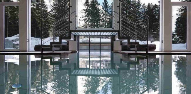 Luxury Indoor Swimming Pool with Natural Outdoor View